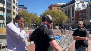 Philip Anderson, a free speech rally leader, punched by counter protester and pu