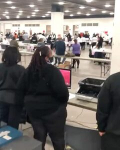 """""""TCF Center in Detroit—poll workers clap and cheer every time Republican attorneys and observers are removed while they count absentee ballots."""