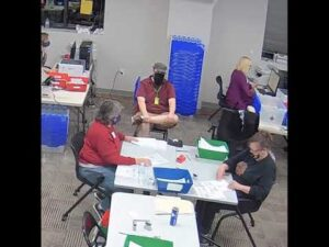 Delaware County Pennsylvania filling out the ballots AND stamping them, possibly backdating them!