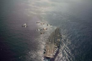 Over the open waves.@USNavy and Moroccan aircraft fly over @TheCVN69 during Lig