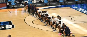 Read more about the article The Entire Georgetown Team Kneels For The National Anthem, Proceeds To Lose By 2