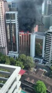 Fire consumes the top floors of a high rise building in the Philippines.  Arson