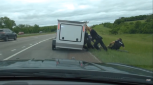 Read more about the article A trailer fell on a man's head as he attempted to change a tire on a Kansas highway. Police officers banded together to free him.
