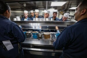 Read more about the article Ice cream social time!  Sailors assigned to the wardroom onboard the Arleigh bu
