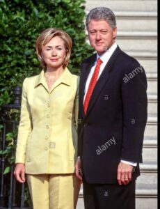 """Read more about the article Unless Hillary was wearing 6"""" platform heels in the 90s, who is this new, older"""